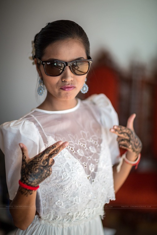 "Showing off my ""gansta"" hands with the traditional, tribal tattoos from henna for our Filipino wedding in Boracay, Philippines. Photo courtesy of Conor Musgrave Photography."